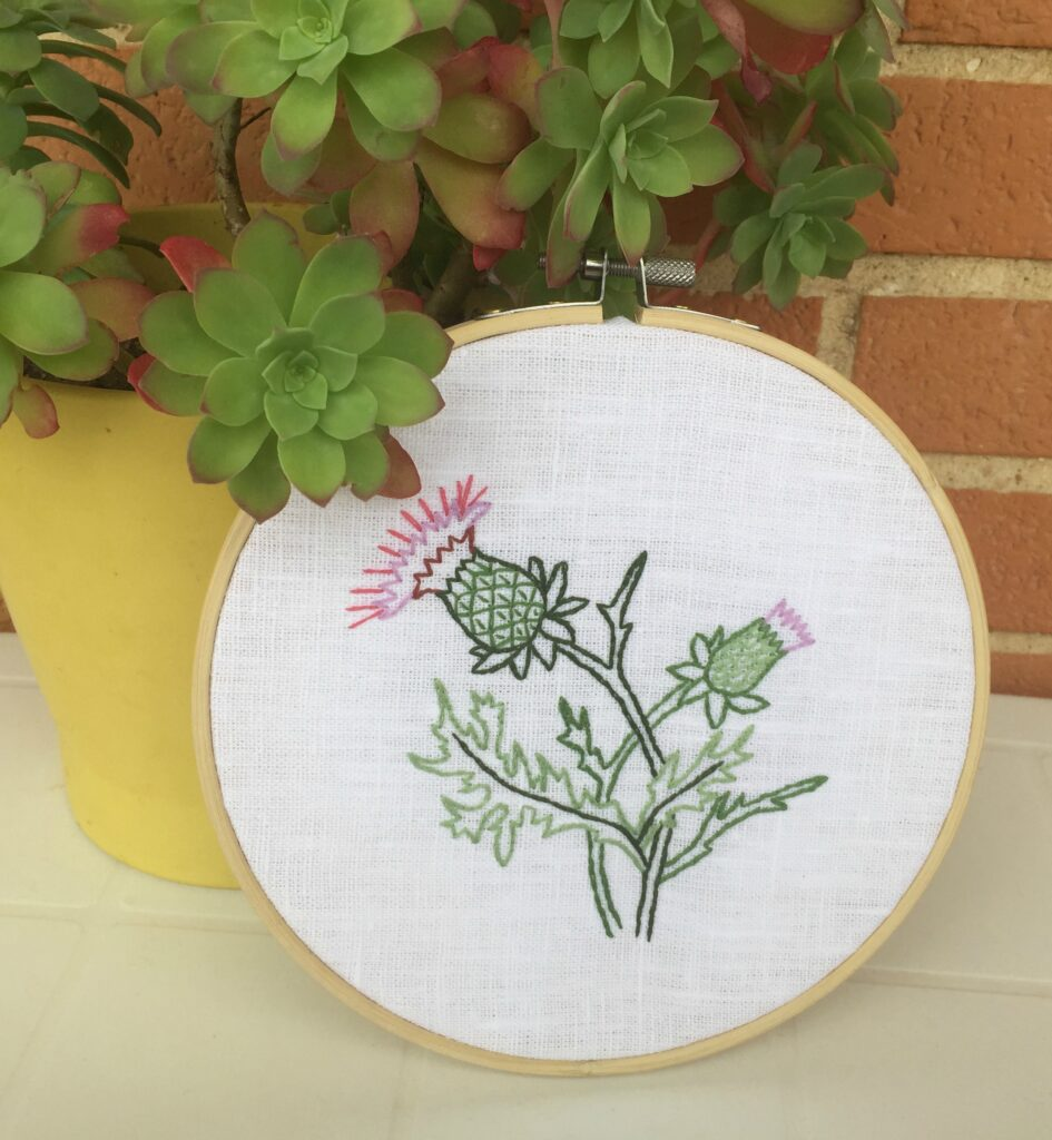 Thistle flower hand embroidery in a hoop wall hanging