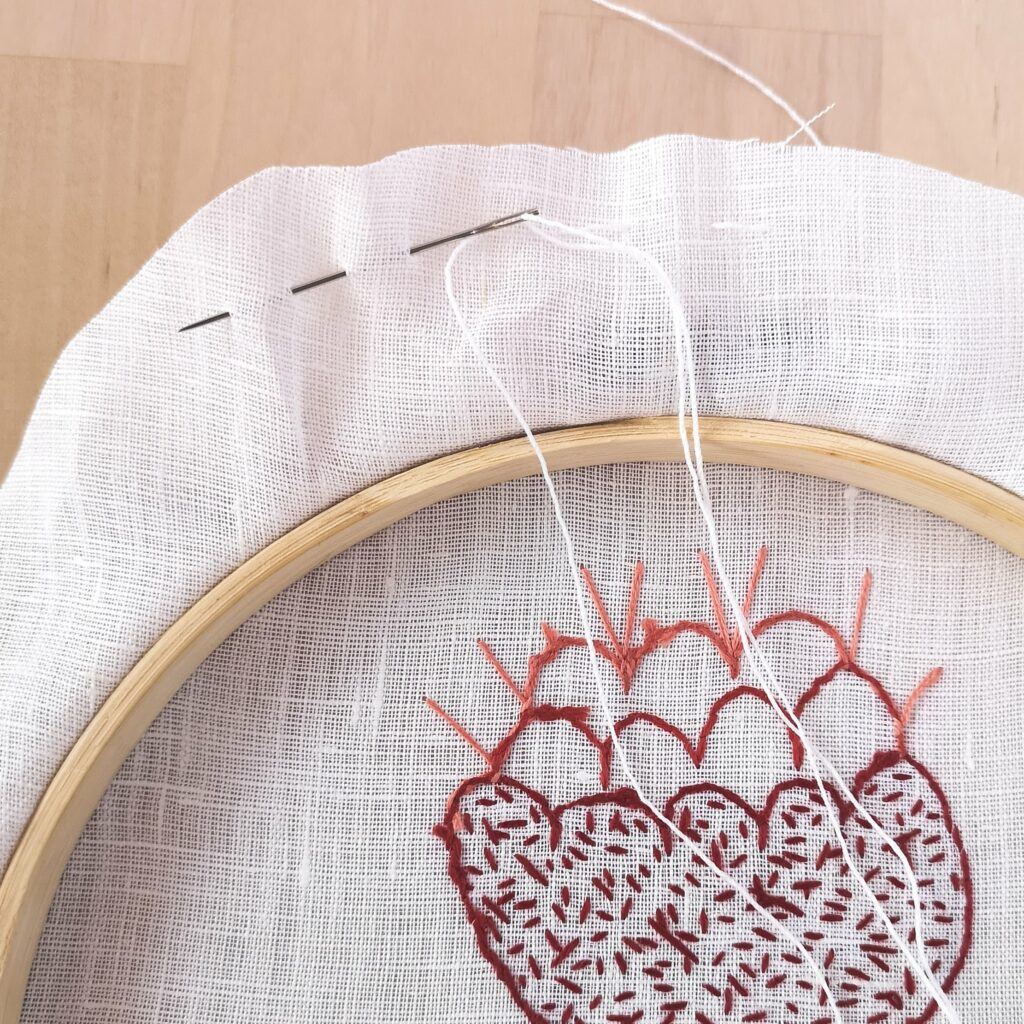Framing the embroidery in a hoop, running stitch