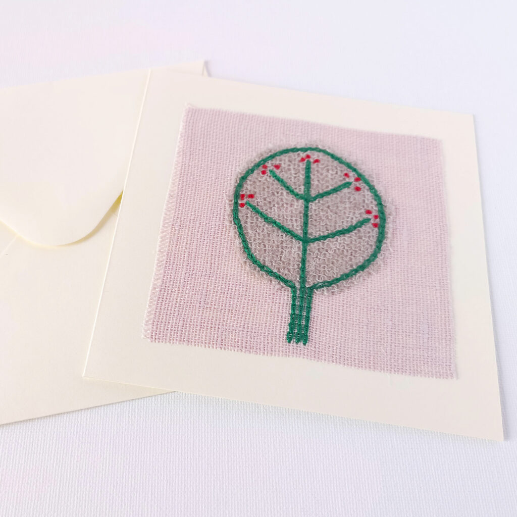 Hand embroidered postcard with green tree