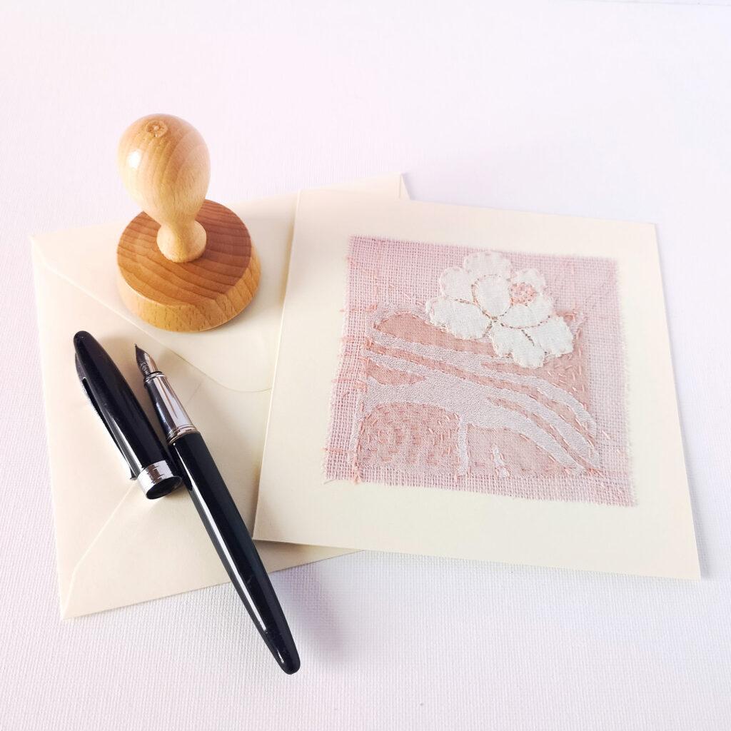 Postcard with floral lace applique
