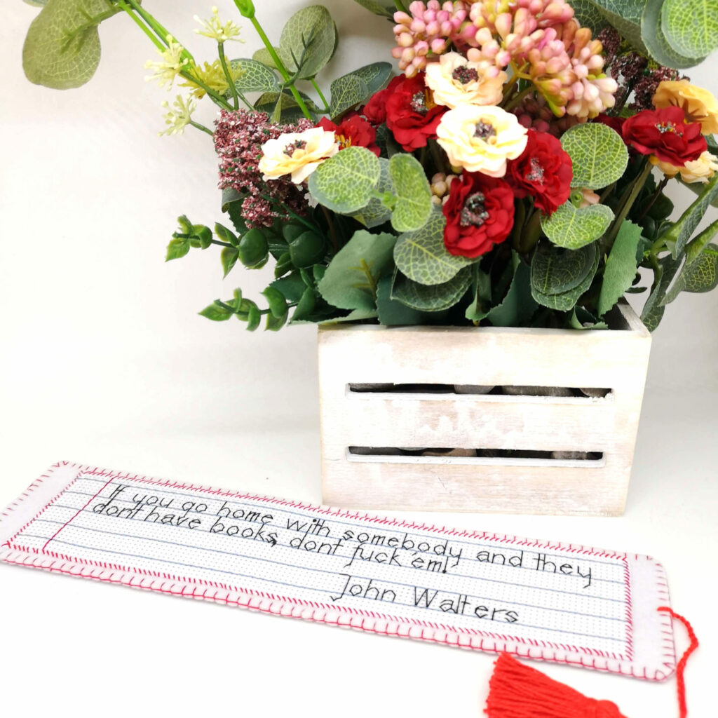 Hand embroidered bookmark with red tassel