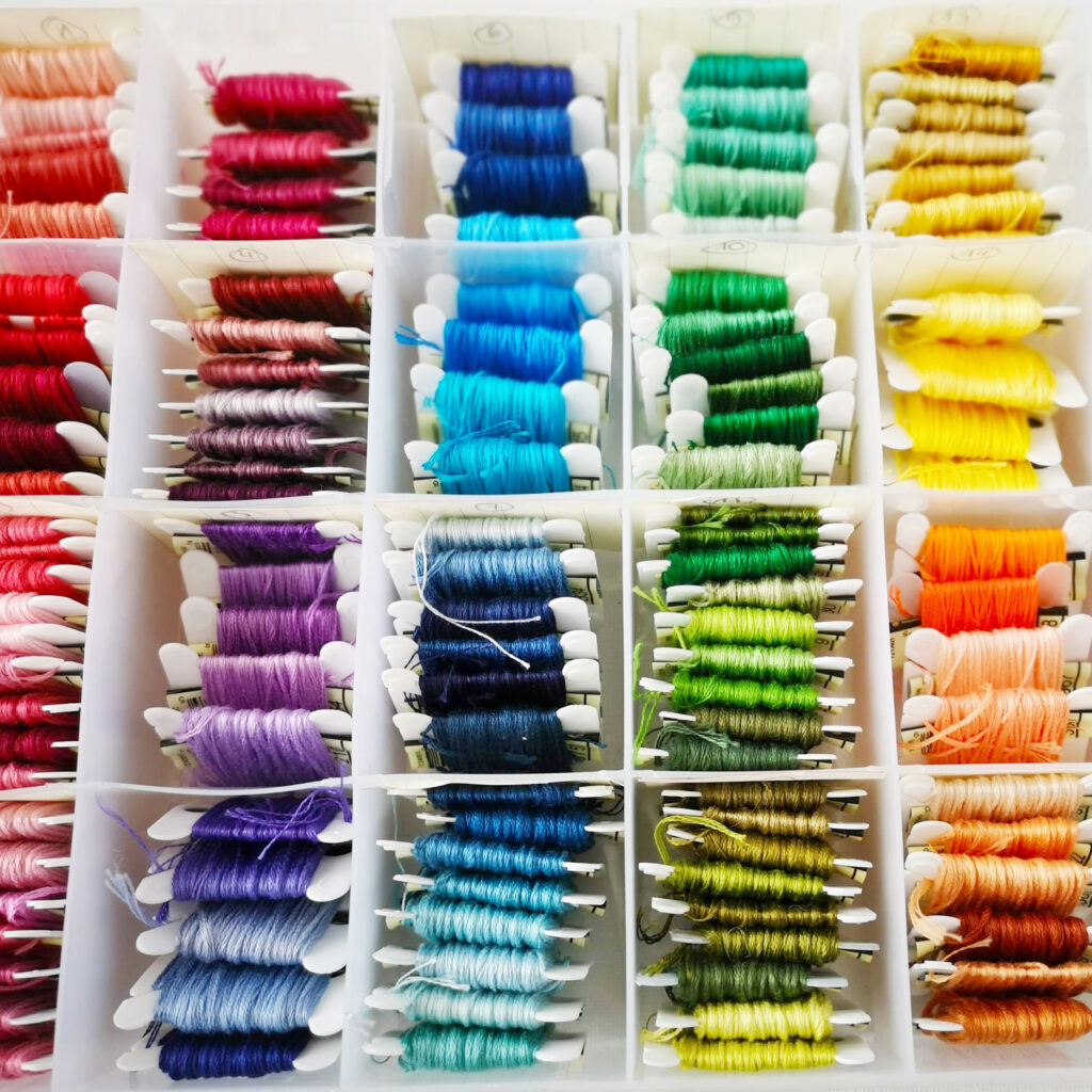 Embroidery floss winded on bobbins in a box