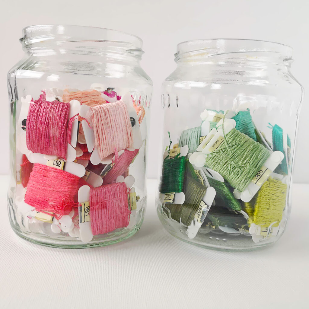 Embroidery floss in a glass jar