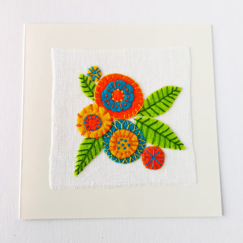 Embroidered postcard with colorful floral applique