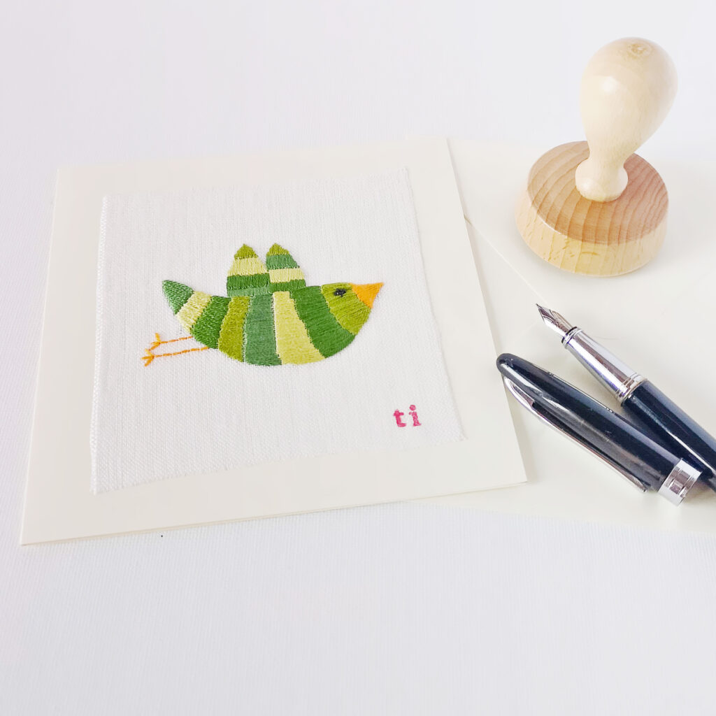 Greeting card with bird embroidery